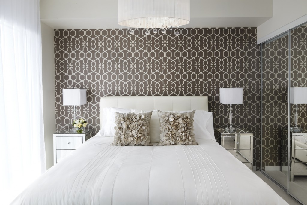 7 space saving tips for a small condo for Space wallpaper bedroom